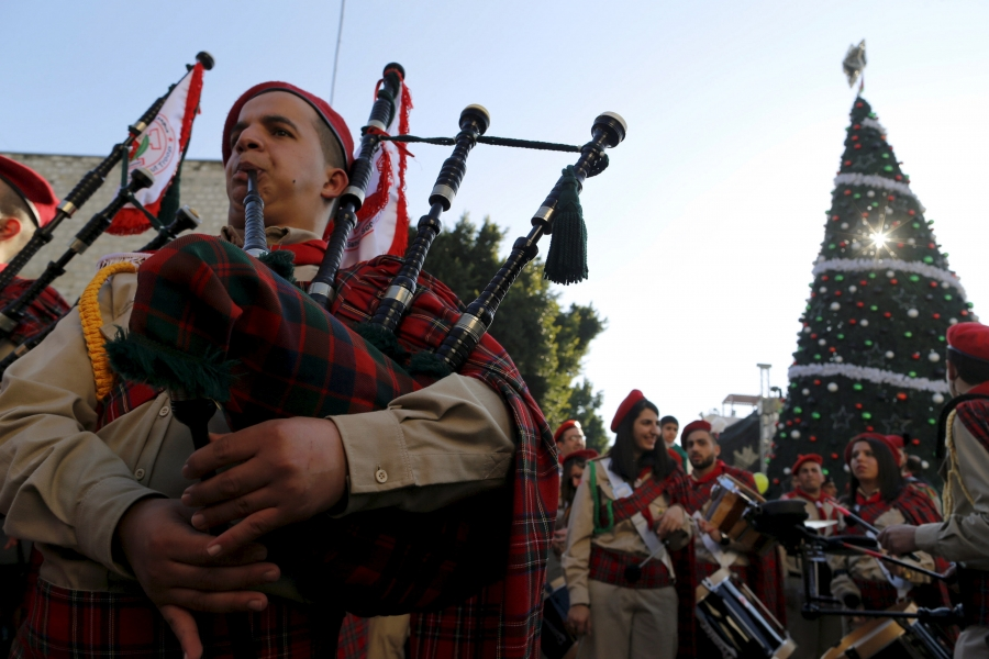 A Palestinian marching band parades during a Christmas procession at Manger Square in the West Bank city of Bethlehemm Dec. 24, 2015.