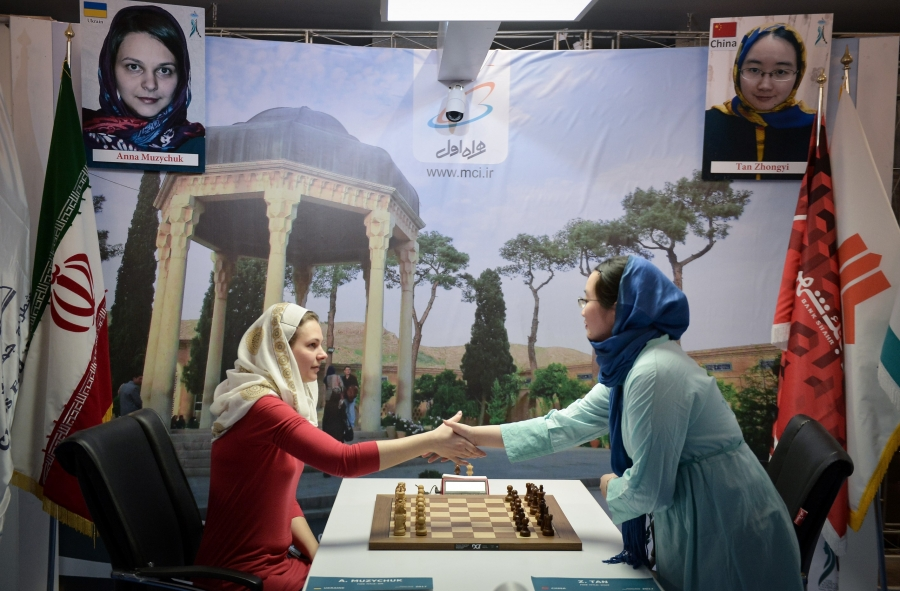 Anna Muzychuk shakes hands with Tan Zhongyi at the Women's World Chess Championship in Tehran, Iran on March 03, 2017.