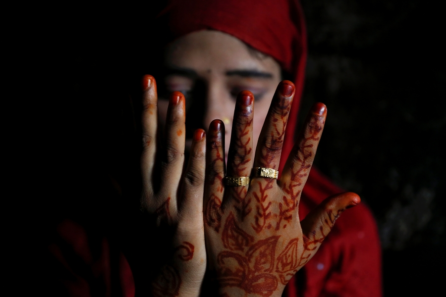 Shofika Begum shows decoration on her hands