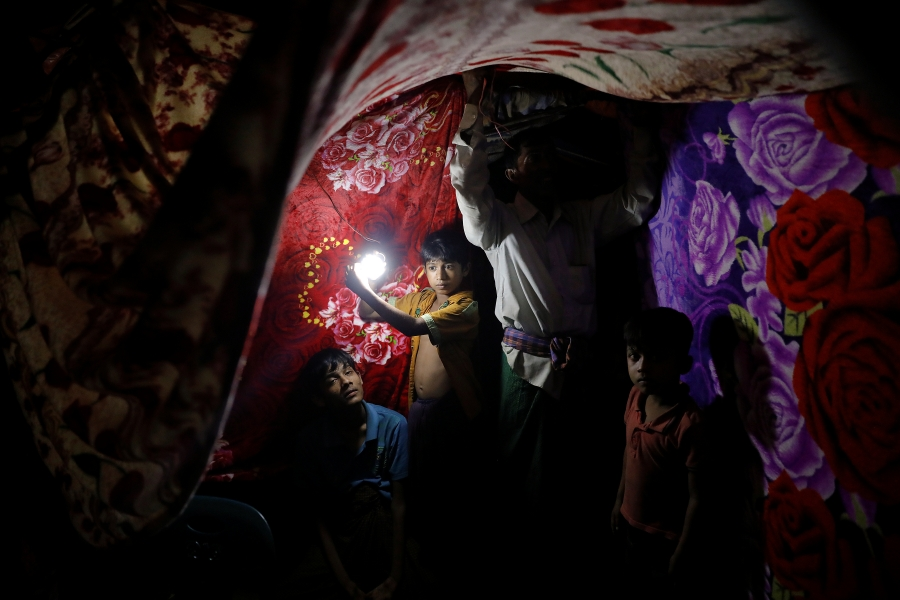 A refugee tent is decorated by colorful blankets for the wedding ceremony.
