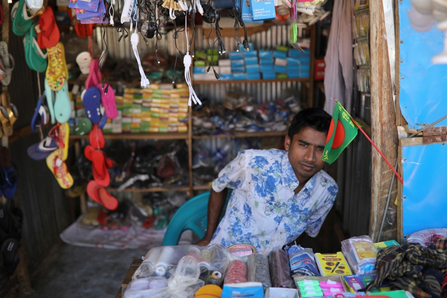 Saddam Hussein works at his family's shop at the Kutupalong refuge