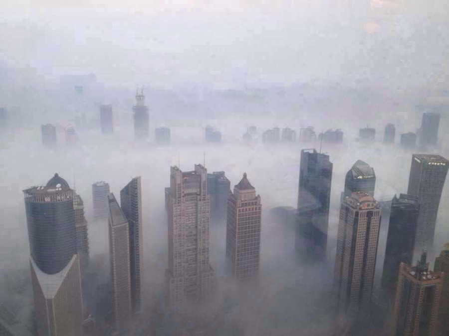 Smog chokes downtown Shanghai on a daily basis. China has recently started a carbon market initiative to reduce its emissions by charging for what is deemed as excessive based on governmental guidelines.
