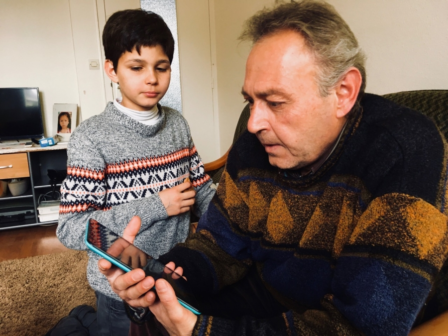 Mahmoud al-Hayek and his son Assad in their apartment in Saint-Nazaire, where they were placed by the EU's relocation program for refugees. The family is originally from Aleppo, Syria.