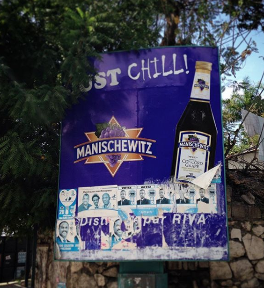 Billboard showing ad for wine