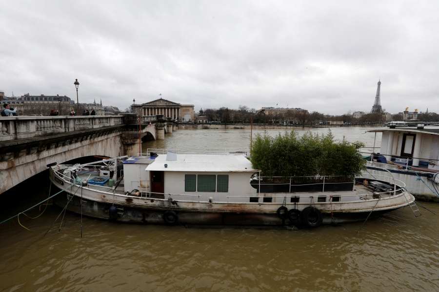 A view shows a peniche boat that is moored along the flooded banks of the River Seine.