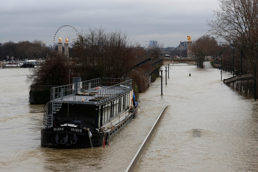 A view shows a peniche boat moored along the flooded banks of the River Seine after days of almost non-stop rain caused flooding in the country in Paris, France.