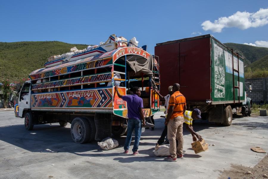Haitian customs workers inspect a bus in Malpasse, Haiti, near the Dominican border.