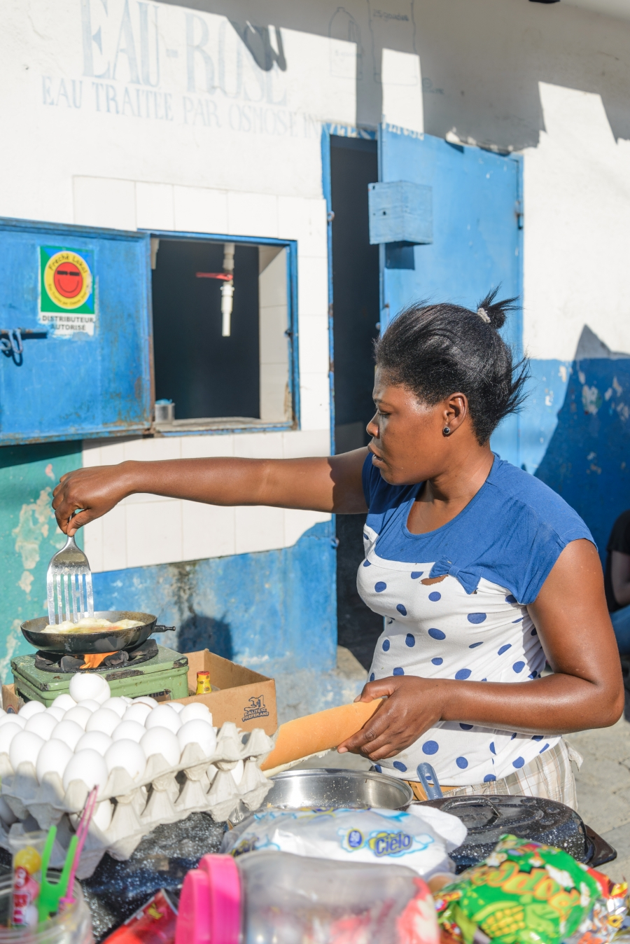 Phita, who did not give her last name, sells cooked eggs in Marché Salomon, in Port-au-Prince, Haiti.
