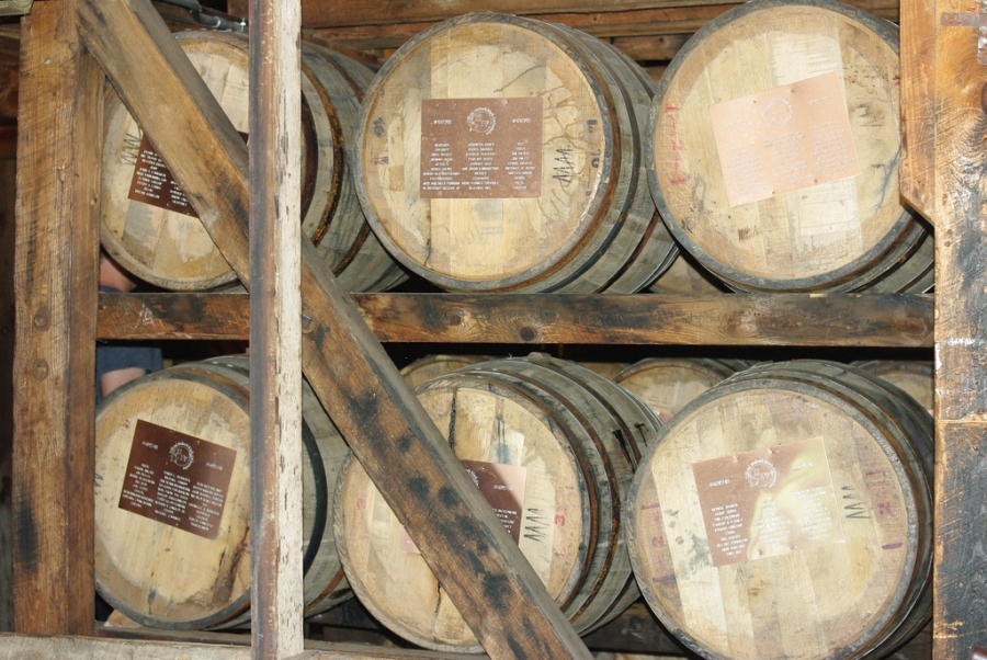 Bourbon barrels age at the Maker's Mark Distillery. The aging process can vary greatly, depending on the desired taste of the end product.