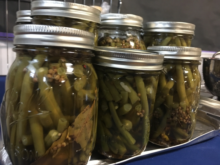 Green beans packed in glass jars