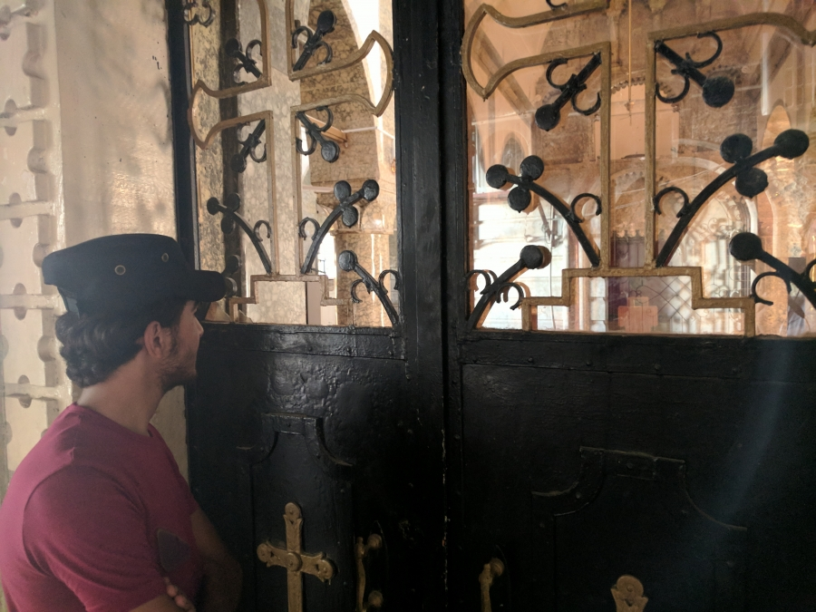 Ibrahim, 17, looks through the gates of a church damaged by ISIS fighters in Bartella, Iraq. He says his Christian faith helped him survive two years as an ISIS prisoner. But since his release, the ordeal has made him question religion.