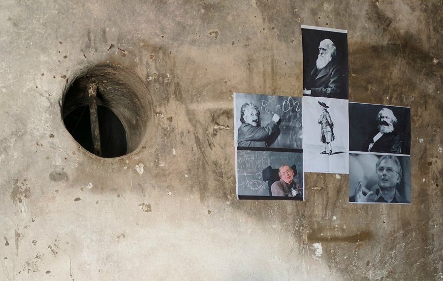 On the wall of his home, Ibrahim has put up portraits of Charles Darwin, Karl Marx, Albert Einstein and others.