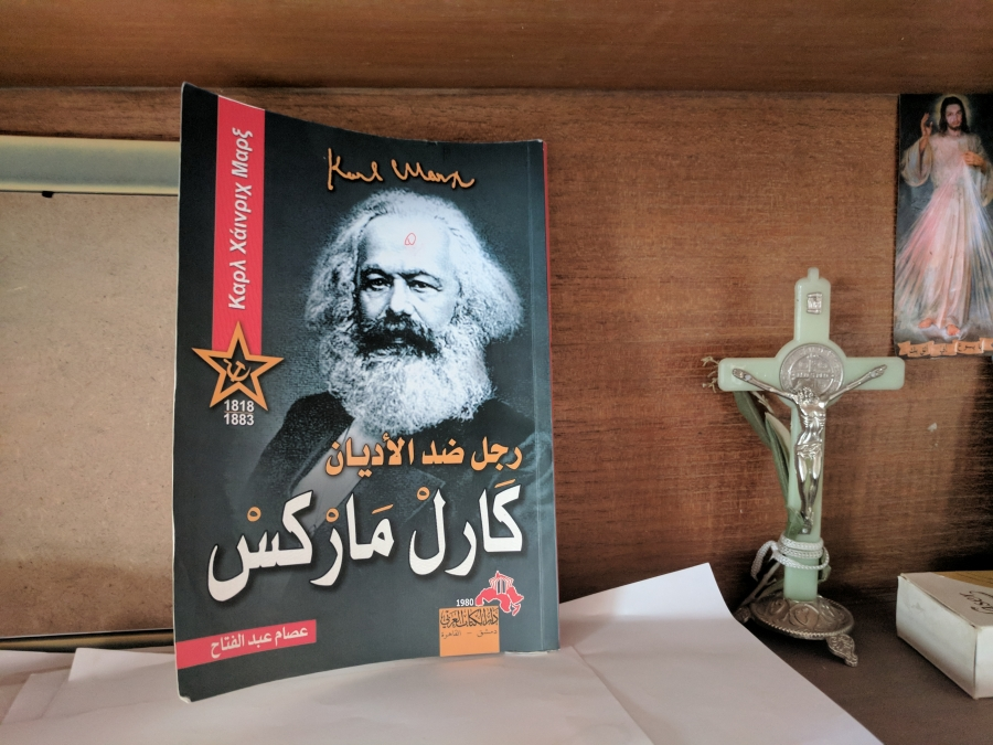 At Ibrahim's home, Karl Marx shares a bookshelf with Jesus Christ.