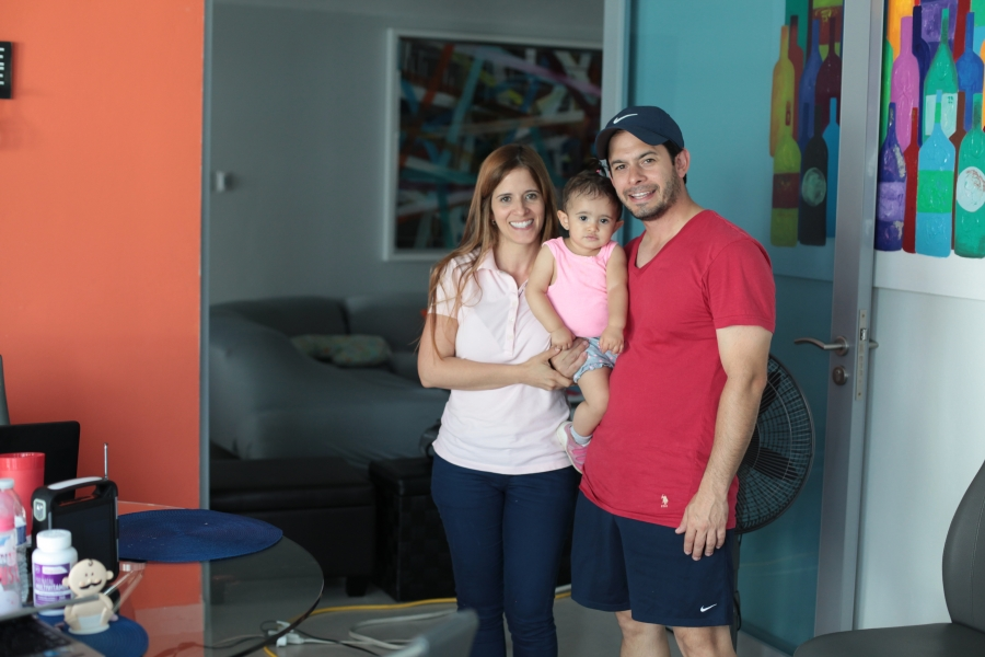 Rosa Lopez and Jose Quiñones, with their daughter Joyce. The new solar battery pack for the family's home cost $10,000, but the outlay means they no longer have to depend on an unreliable grid or an expensive part-time generator.