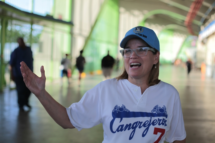 San Juan Mayor Carmen Yulin Cruz speakingafter throwing the cermonial first pitch at a celebrity baseball game. Yulin dreams of transforming the city's electric supply and thinks solar has real promise as part of that effort.