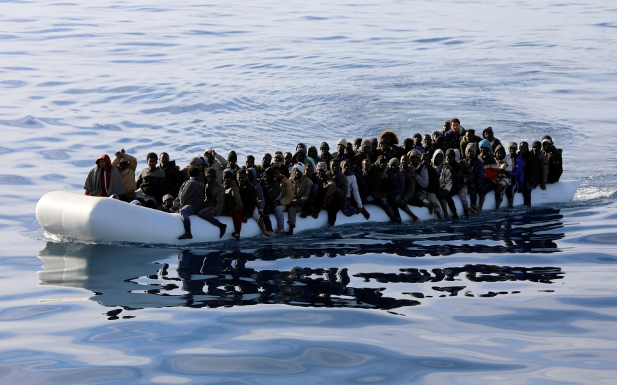 Migrants in a rubber dinghy are rescued by Libyan coast guards in the Mediterranean Sea off the coast of Libya, Jan. 15, 2018. Stories of rape along the migrant route through Libya are so common that many women who traveled it reported bringing contracept