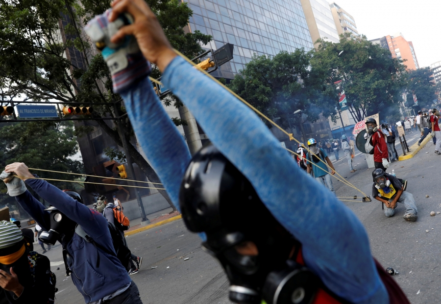 Demonstrators use a giant slingshot while clashing with security forces during a rally against Venezuela's President Nicolas Maduro in Caracas, Venezuela, May 20, 2017.
