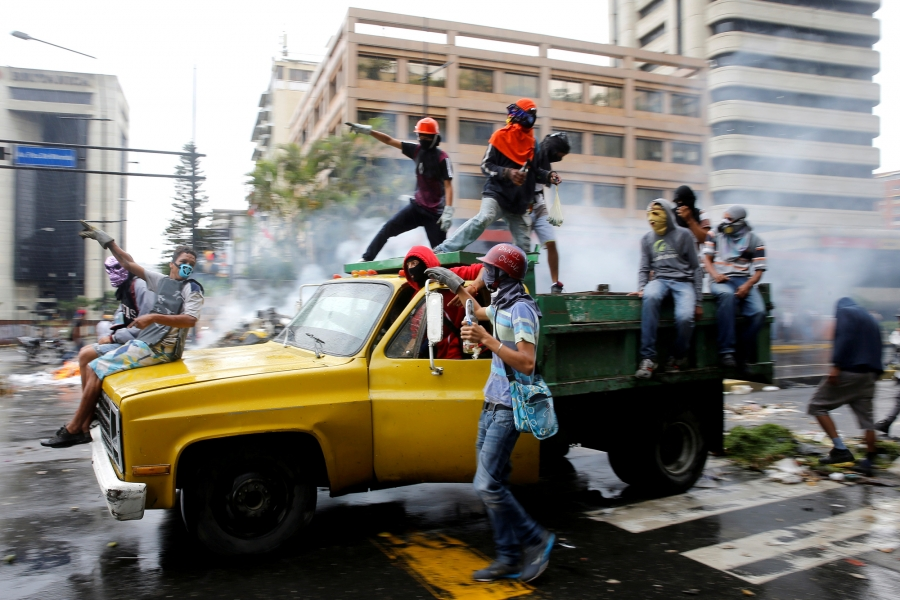 Demonstrators ride on a truck while rallying against Venezuela's President Nicolas Maduro's government in Caracas