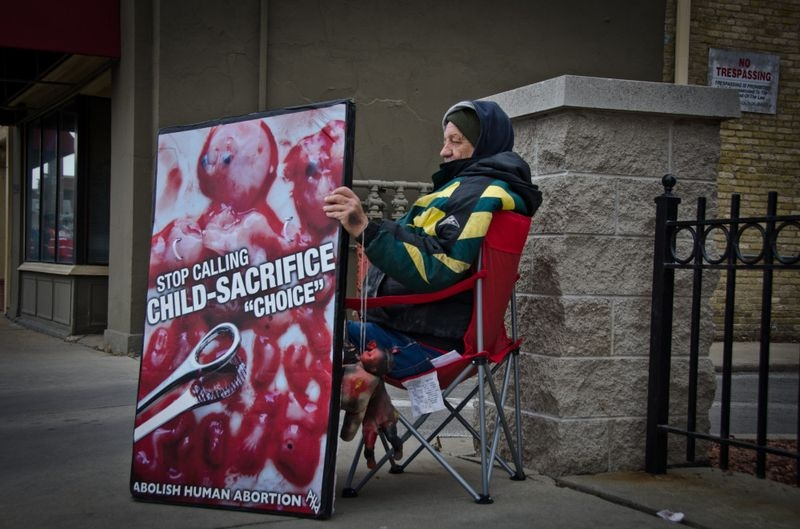 A demonstrator outside Affiliated Medical Services in Milwaukee, Wisconsin.