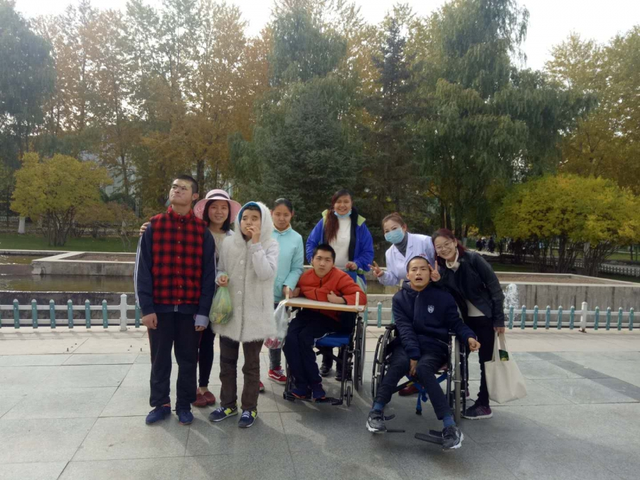 Bingjie Turner and Abigail Anderson with residents at the Xinxin Children's Home