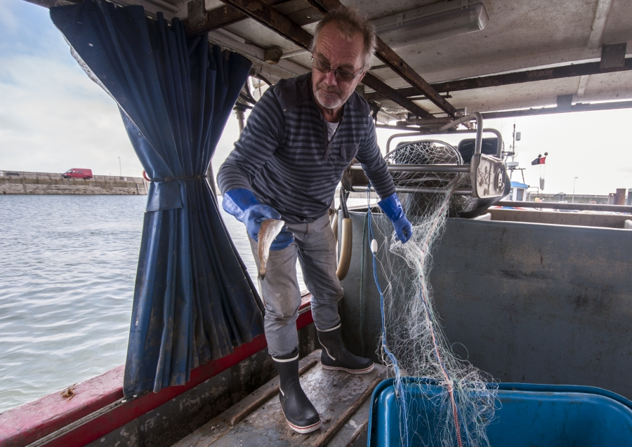 Fisherman Steve Barratt aboard his boat Razorbill in the Ramsgate harbor.