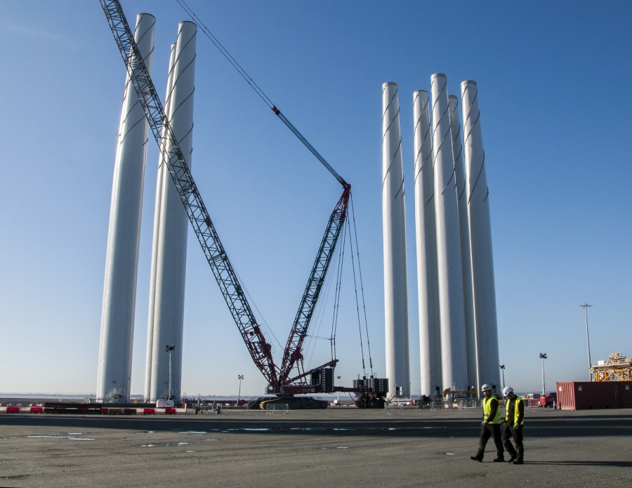 Outside the Siemens warehouse in Hull, turbine towers wait to be fitted with blades.