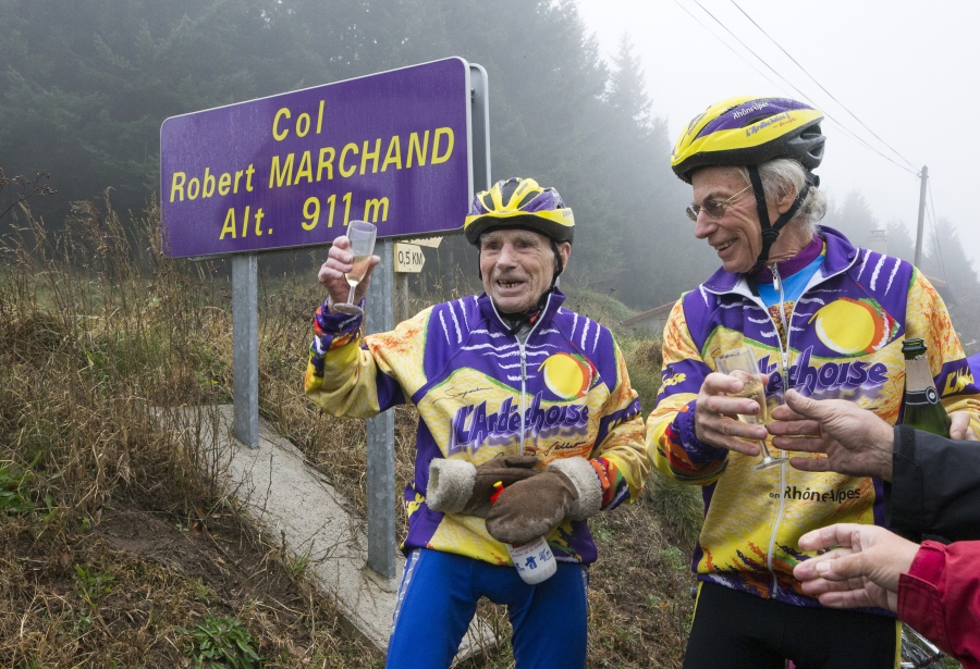 French cyclist Robert Marchand (L), raises a glass of champagne to celebrate his 103rd birthday
