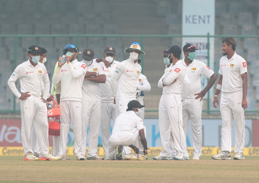 Sri Lankan cricket players wear masks during a match against India in Delhi, Dec. 5, 2017. Play was interrupted multiple times while the Sri Lankans complained about air quality levels, which were at least 15 times higher than World Health Organization st