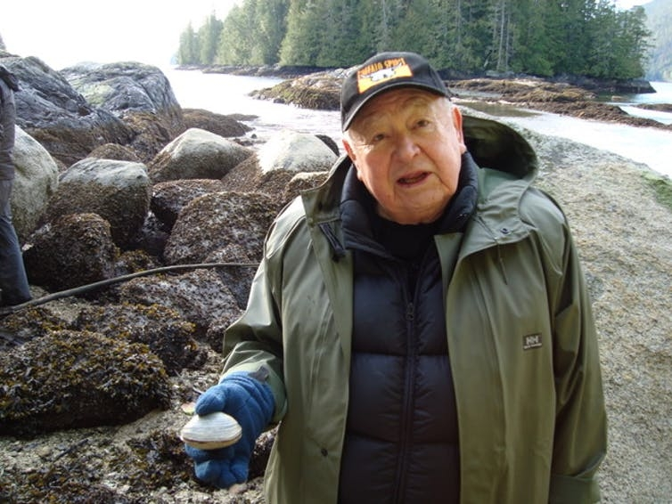 Kwaxsistalla Chief Adam Dick with a butter clam.
