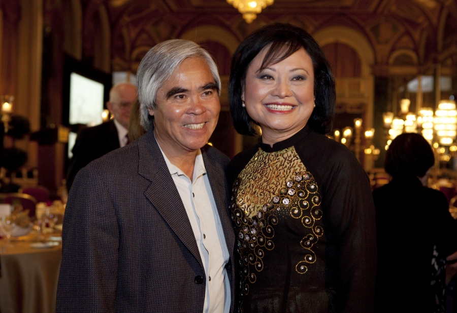 """Photojournalist Nick Ut and Kim Phuc Phan Thi pose for pictures at the """"40th Anniversary Tribute Dinner in Honour of Kim Phuc Phan Thi"""" in Toronto, June 8, 2012.  In 1972, Ut took the iconic Vietnam War photograph of a naked Kim Phuc running down a road a"""