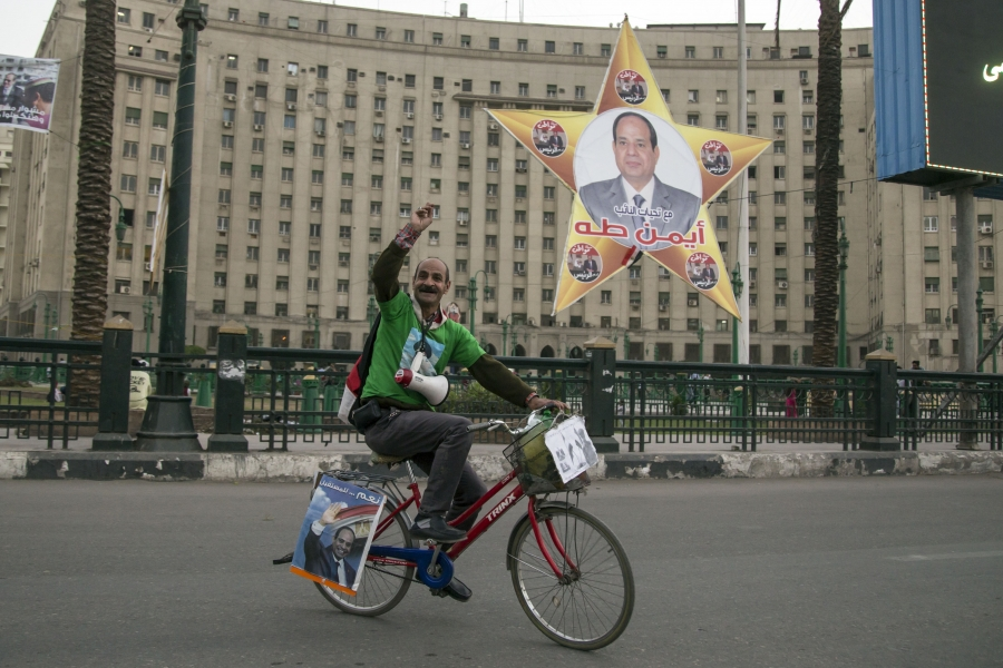 A supporter of Abdel Fatteh el-Sisi campaigns for the president in Tahrir Square ahead of the election today.