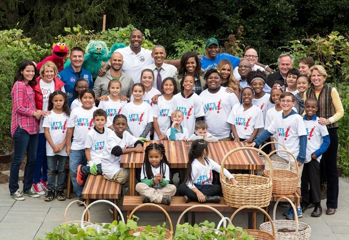 Will Allen (back row, right) at a 2016 White House garden event, alongside Barack and Michelle Obama, Alonzo Mourning, Sesame Street characters and many others.
