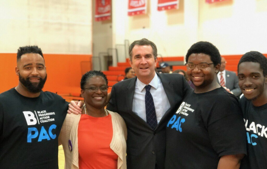 Adrianne Shropshire, second from left, with BlackPAC volunteers and Governor-Elect Ralph Northam, center, in Virginia in November 2017.