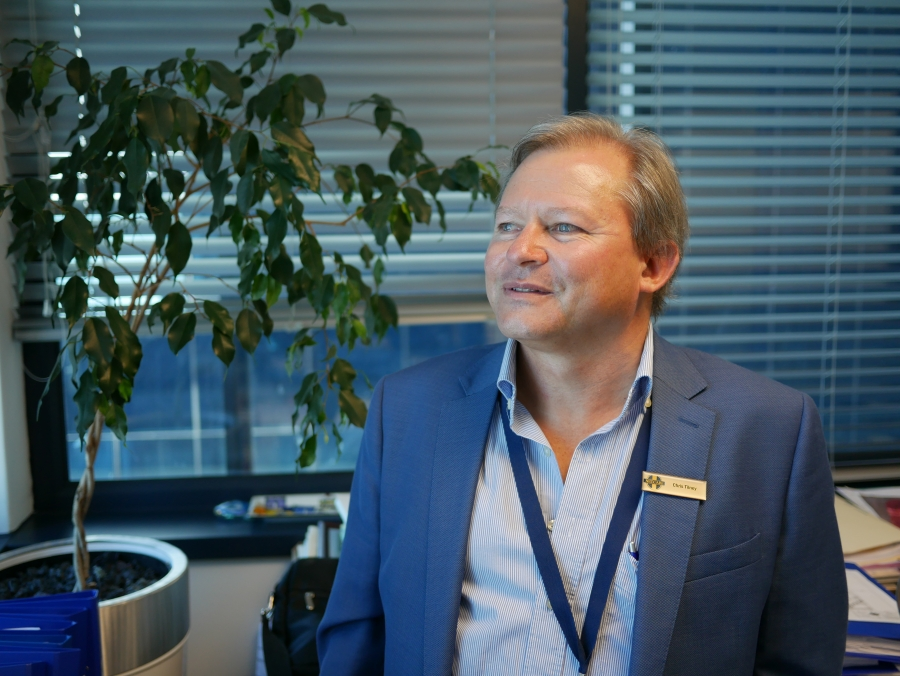 A portrait of Christiaan Barnard Hospital's General Manager Chris Tilney in a blue suit.