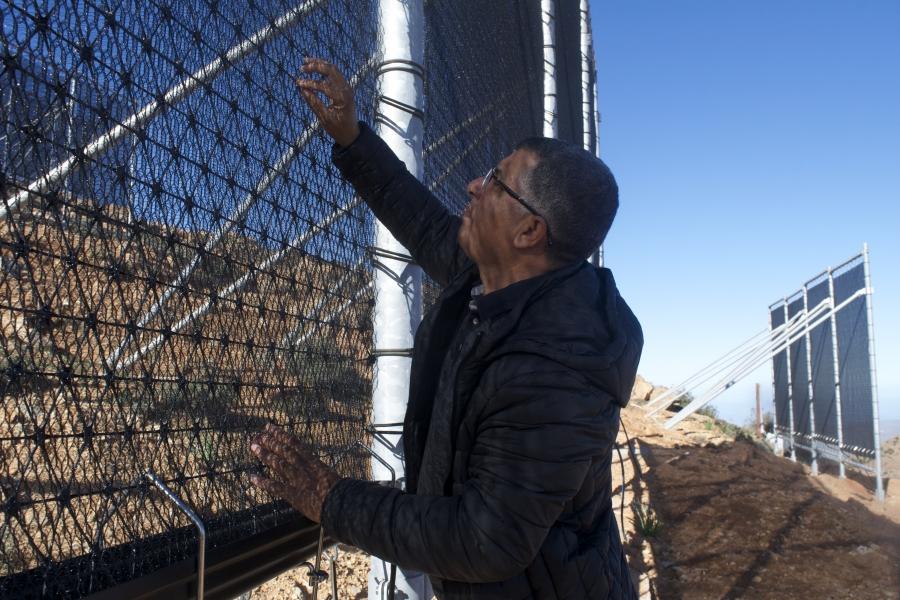 Mounir Abbar next to fog nets