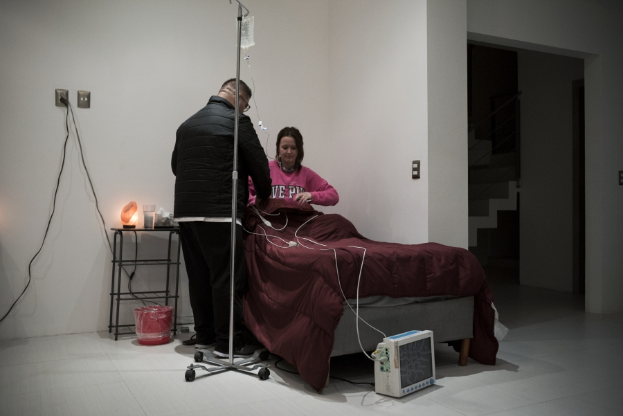 Emily Albert is hooked up to an EKG before she begins her 36-hour ibogaine treatment