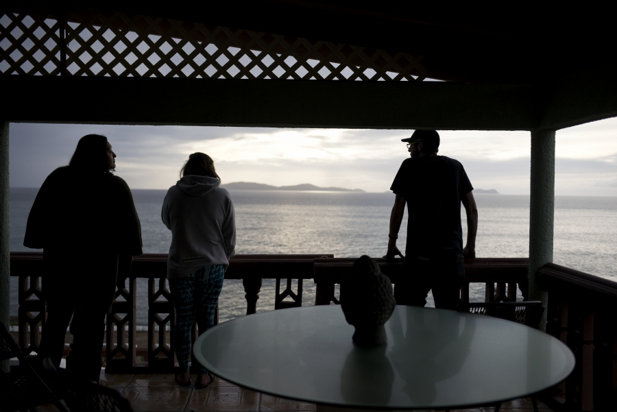 Staff at The Ibogaine Institute, an opioid rehab clinic, look at whales swimming off the Baja coast