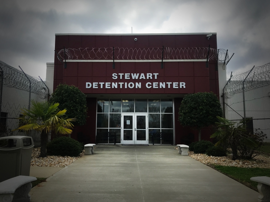 the outside of Stewart Detention Center in the pine woods of southwest Georgia.