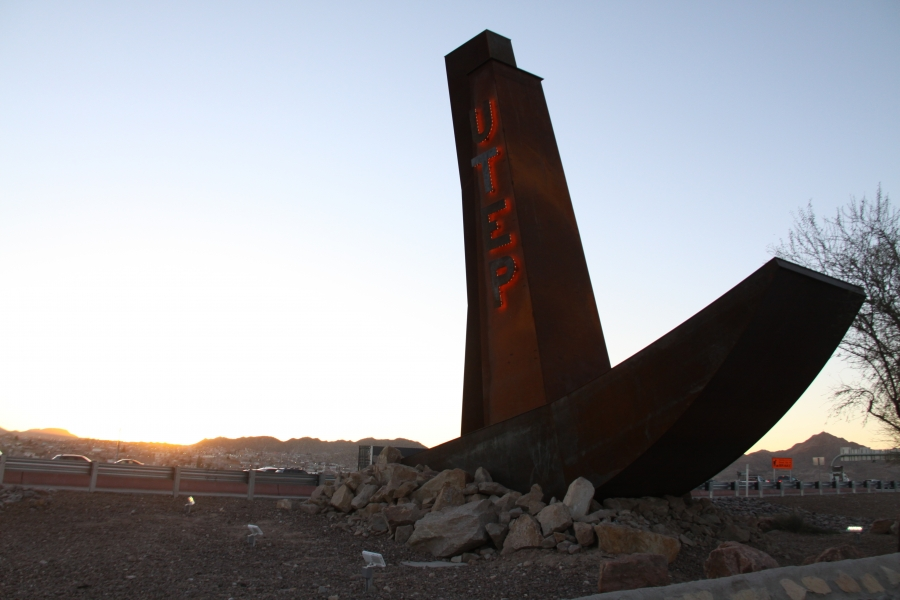 A photo of a UTEP sign right along the US-Mexico border.