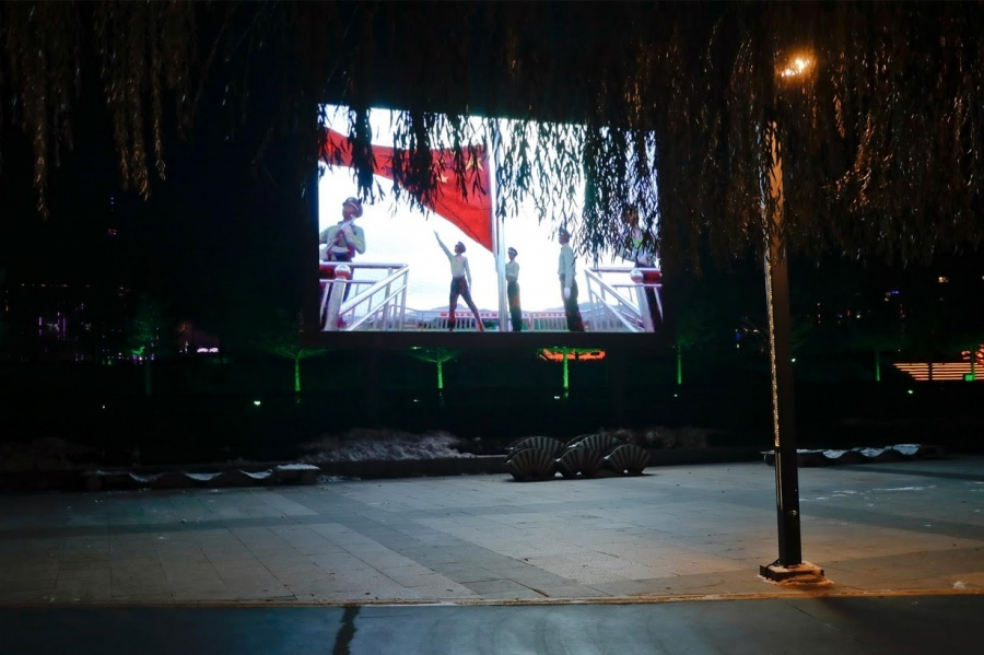 A large screen, which faces North Korea, broadcasts propaganda videos on an island on the Yalu River