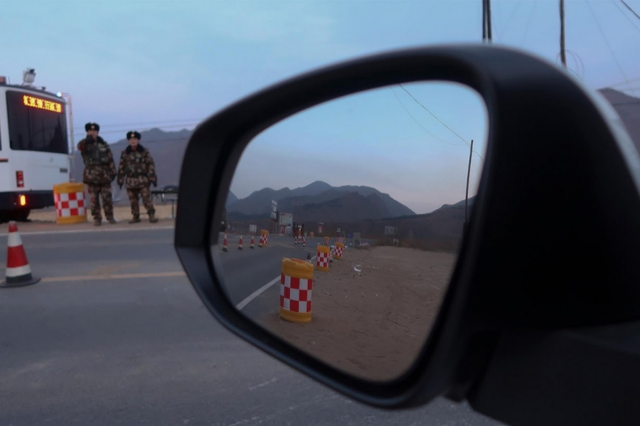 Policemen control a check point after preventing Reuters reporters from driving through, near the border of China and North Korea,