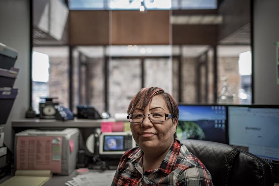 A woman behind a desk