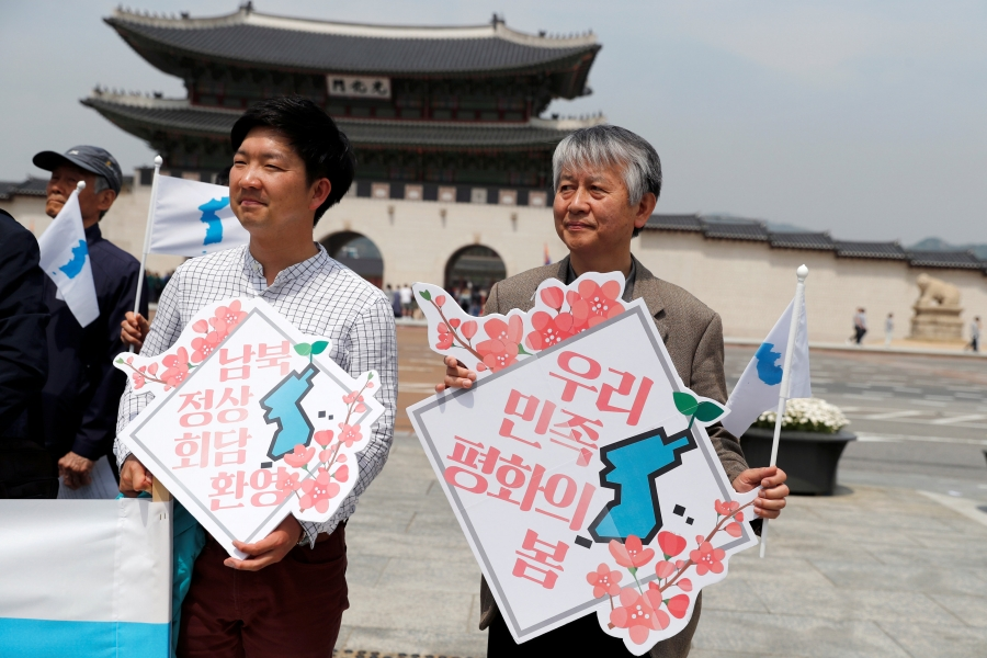 People hold Korean Unification Flags