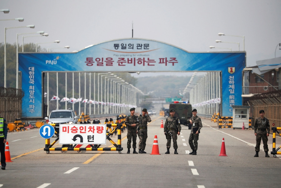 South Korean soldiers stand guard at a checkpoint
