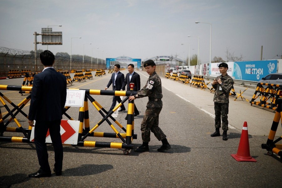 South Korean soldiers and security personnel stand guard at a checkpoint