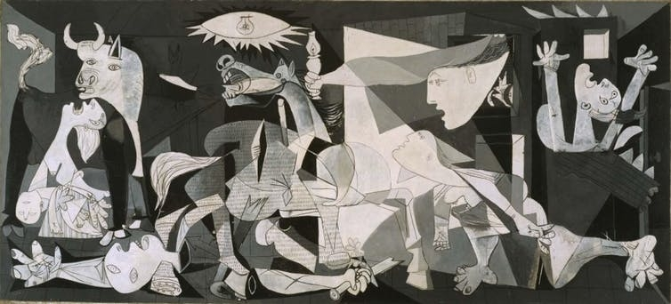 Pablo Picasso's 1937 'Guernica' painting, which is black-and-white abstract art of men and monsters fighting each other.
