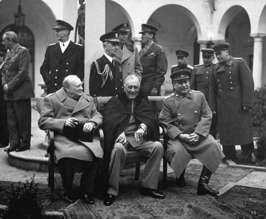 British Prime Minister Winston Churchill, US President Franklin Roosevelt, and Soviet leader Joseph Stalin pose for a photo together at their meeting at Yalta in February 1945, where they agreed to veto power by the 'big five.'