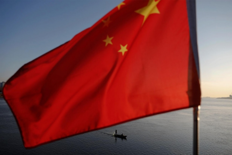 North Korean fishermen are seen as a Chinese flag flutters