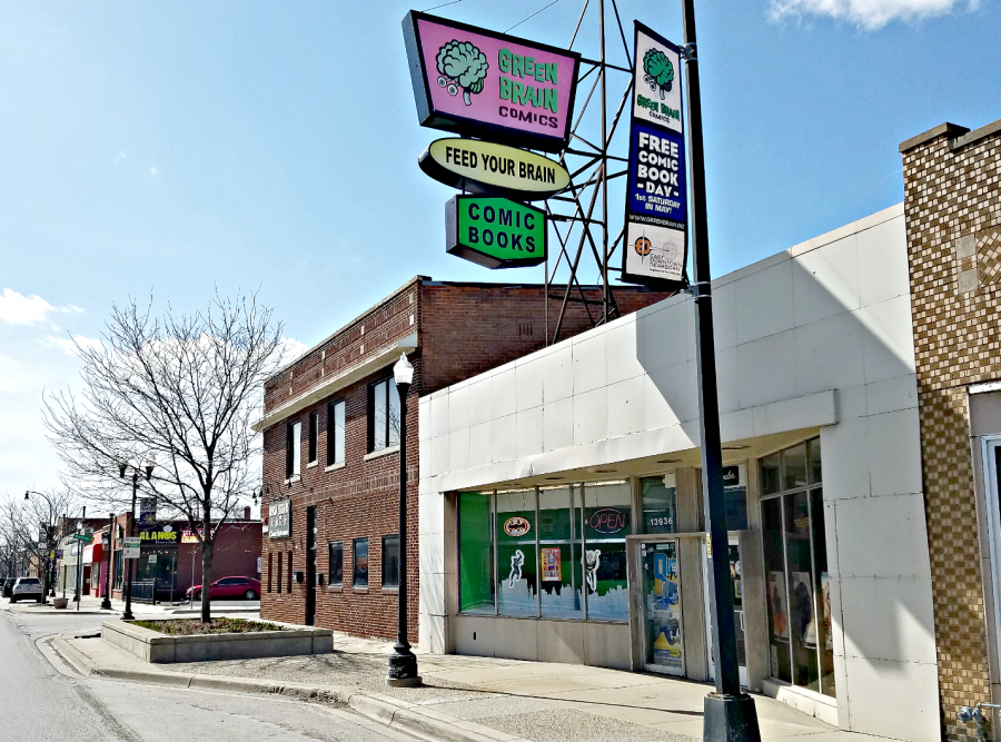 Storefront of Green Brain, simple white walls and large sign