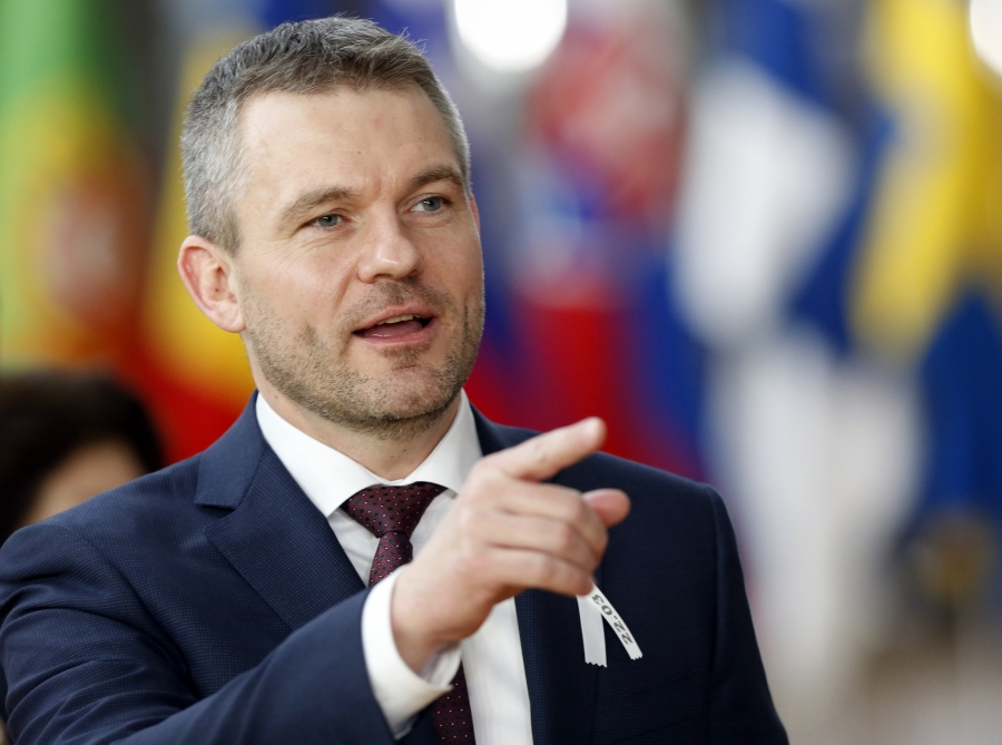 Slovakia's Prime Minister Peter Pellegrini gestures as he arrives at a European Union leaders summit in Brussels, Belgium, March 22, 2018.